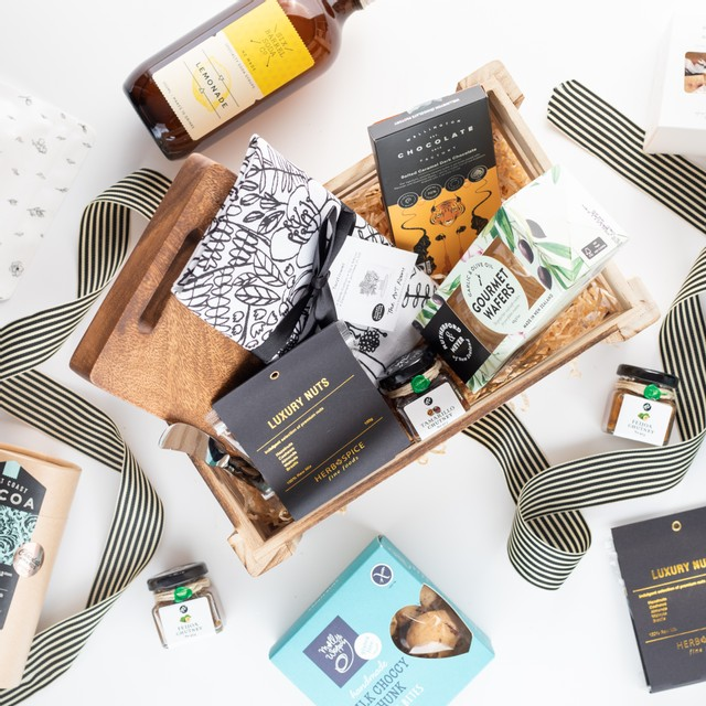Giftology gift box with gourmet items in wooden gift crate